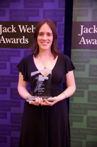 Lisa Hale holds her Webster Award for best radio feature story